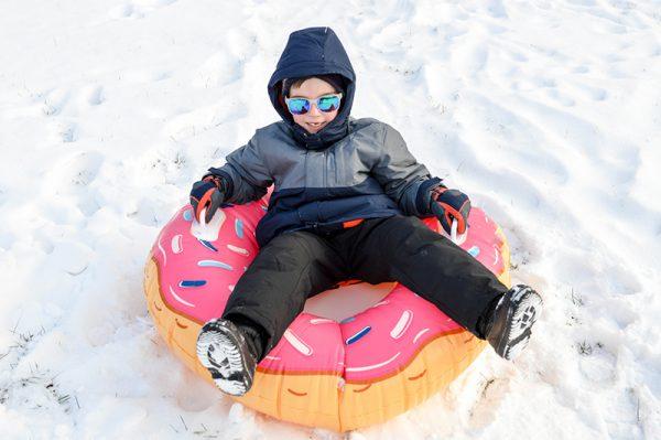 Small child sledding at Keystone Resort