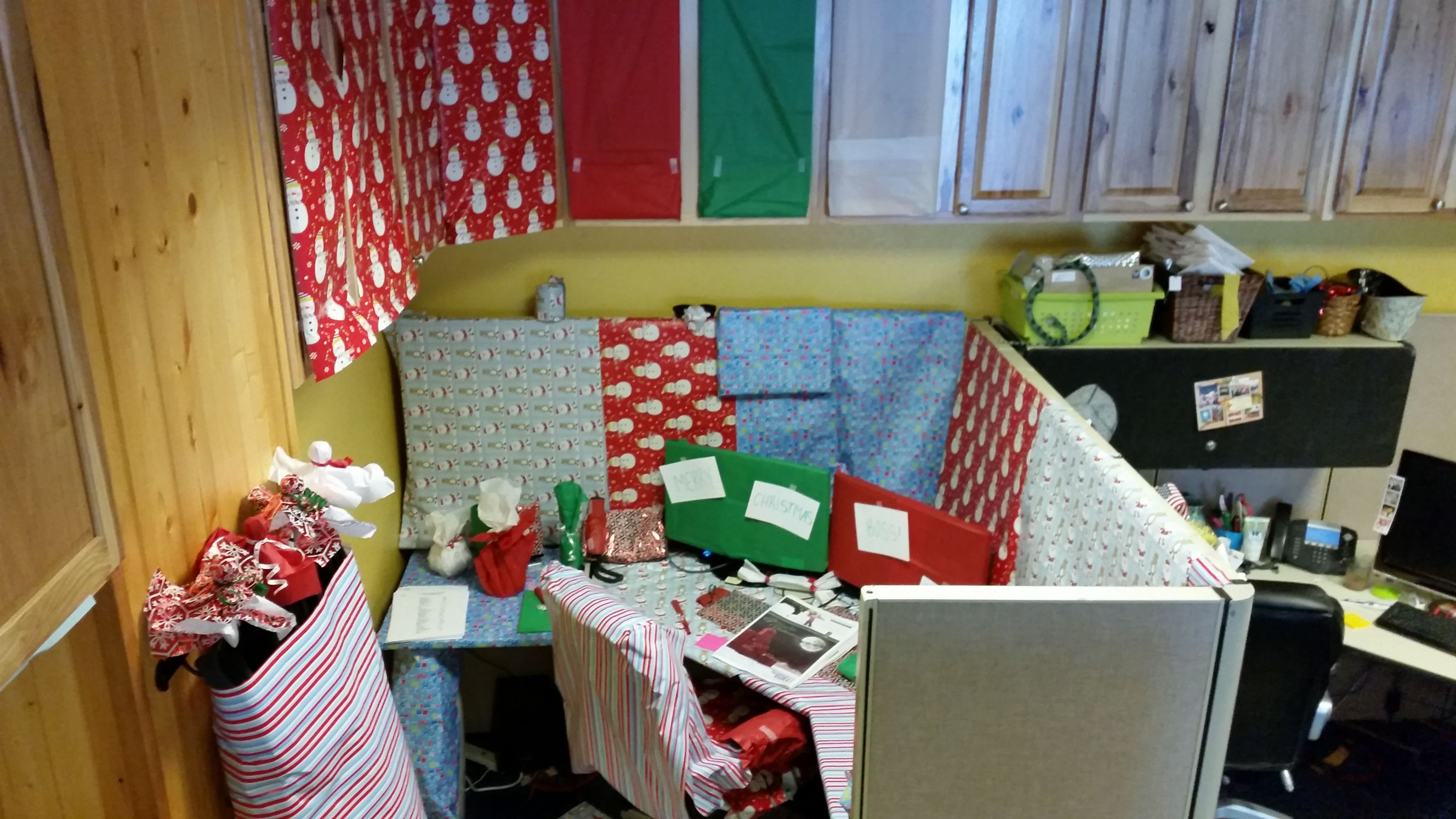 Office decorated in Christmas paper