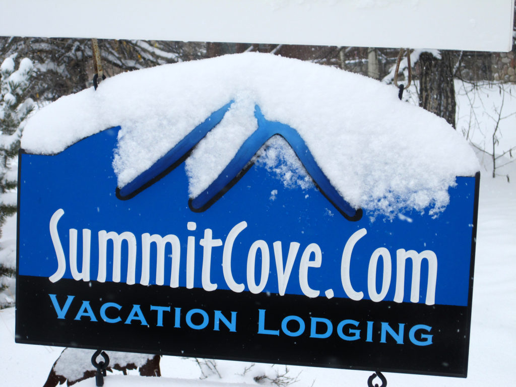 SummitCove Lodging Sign Covered in Snow