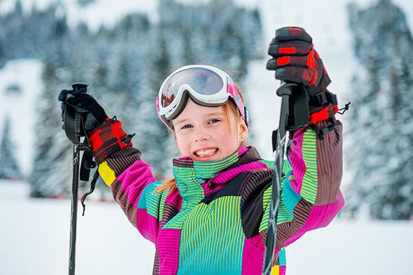 Happy girl skiing in Colorado