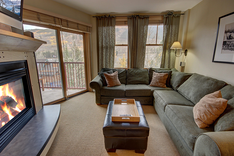 Living room with fireplace and balcony at Silver Mill 8220