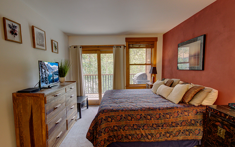Master Bedroom with Balcony at Springs River Run