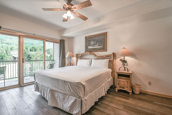 king size log bed in master suite